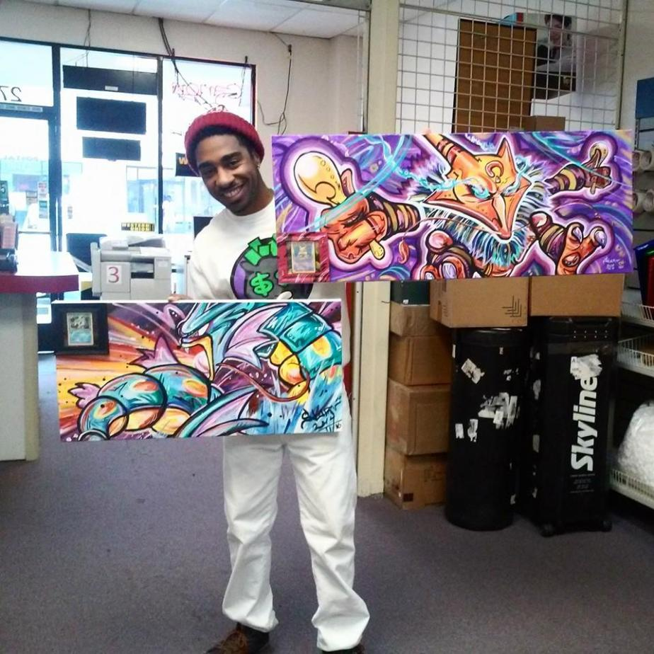 me holding my Alazakam and Gyarados painting up before shipping
