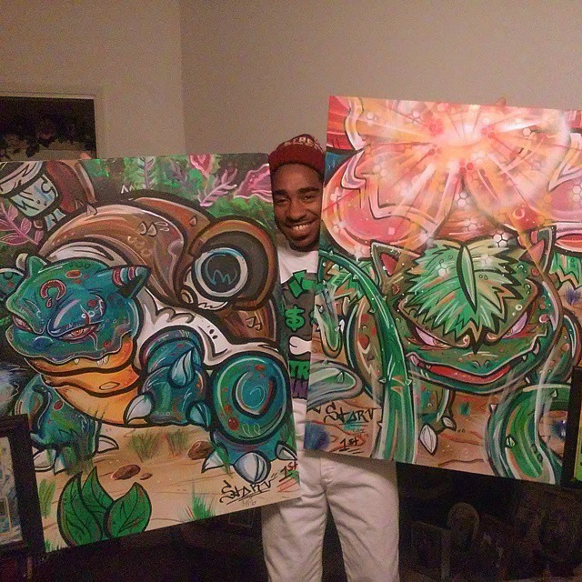 Me holding up Blastoise and Venusaur painting